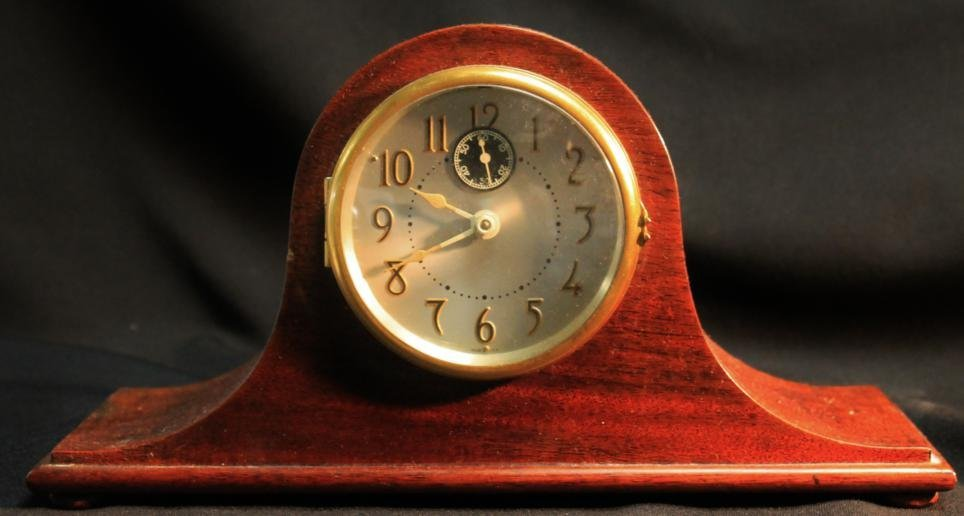 9: Mahogany camel back desk clock