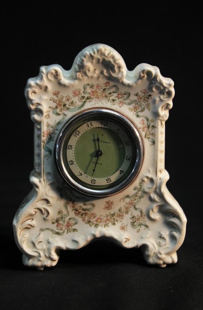 11: Antique porcelain and floral decorated desk clock s