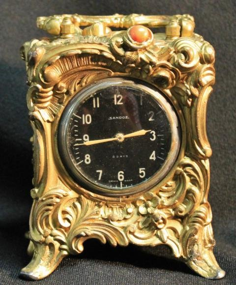 13: Antique carriage clock with jewel movement