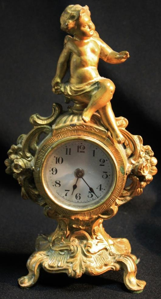 17: Turn of the century winged cupid clock with gold wa