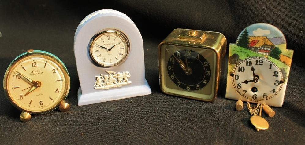 23: Assortment of miniature traveling clocks and more.