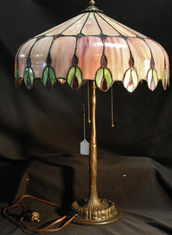 148: Art Nouveau bronze & multi-colored leaded glass ta