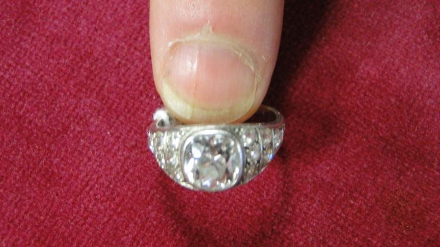 235: 1920's platinum filigree ring with one ct. + cushi