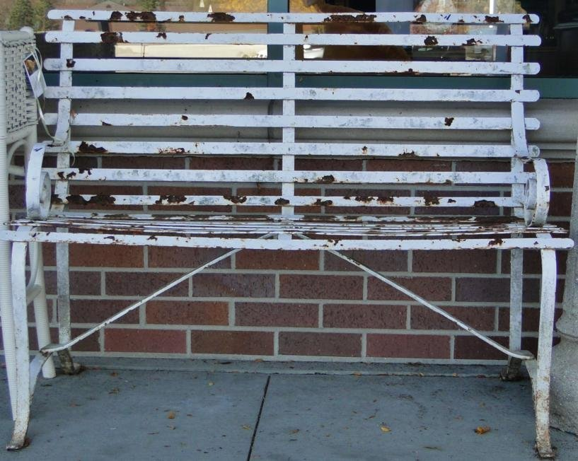 5: A turn of the century rolled arm iron garden bench,