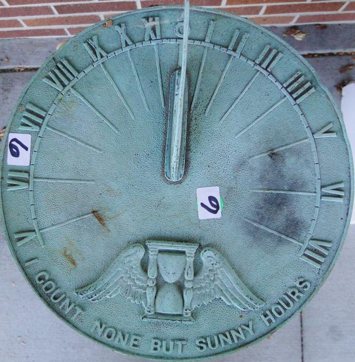 """6: A 1920's sundial, repair noted, 39"""" tall. Est. value"""