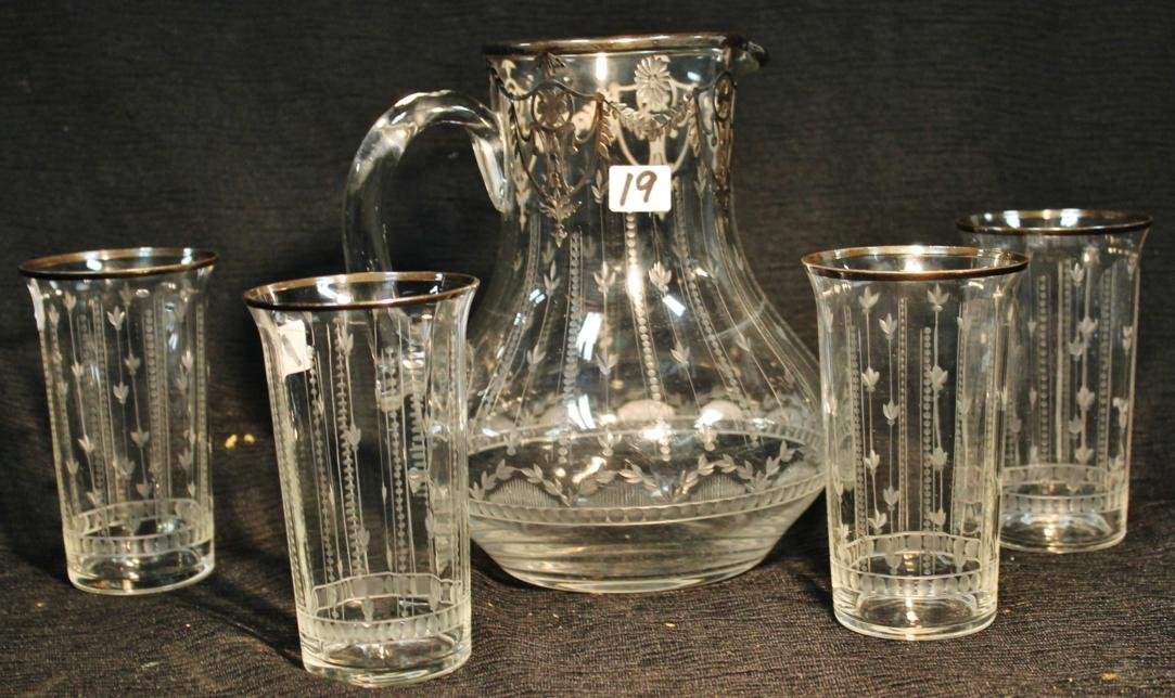 19: A quality hand blown cut crystal with heavy silver