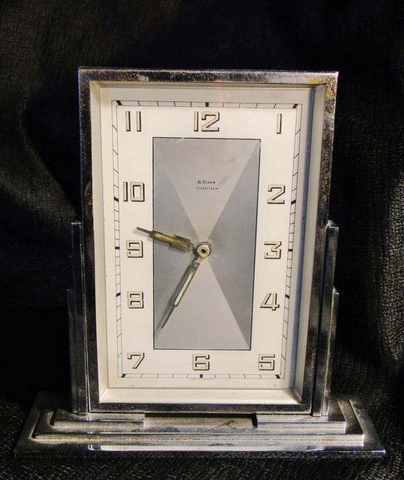 23: A chrome art deco dresser clock made in Switzerland