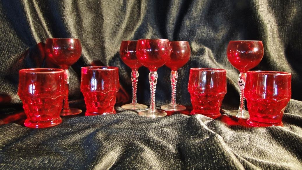 24: 2 sets of ruby glass to include a set of 4 tumblers