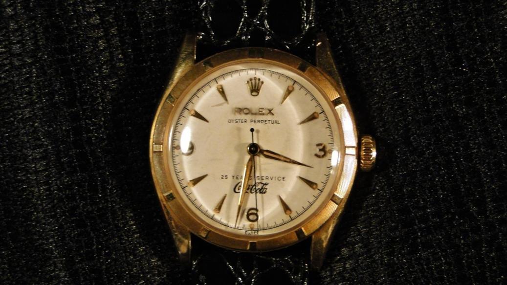 100: A Rolex Coca Cola watch. This Rolex Oyster Perpetu