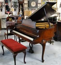 256: A Howard mahogany French carved baby grand piano i