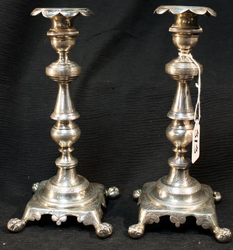 313: Pair of solid silver 18th century claw footed cand