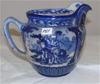 Flow blue milk pitcher w/ jousting scene by Royal Doult