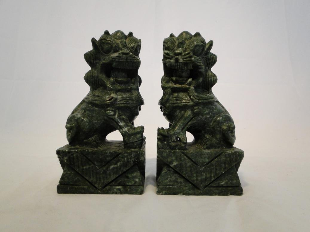 Pair of hand carved stone dragons with movable balls in
