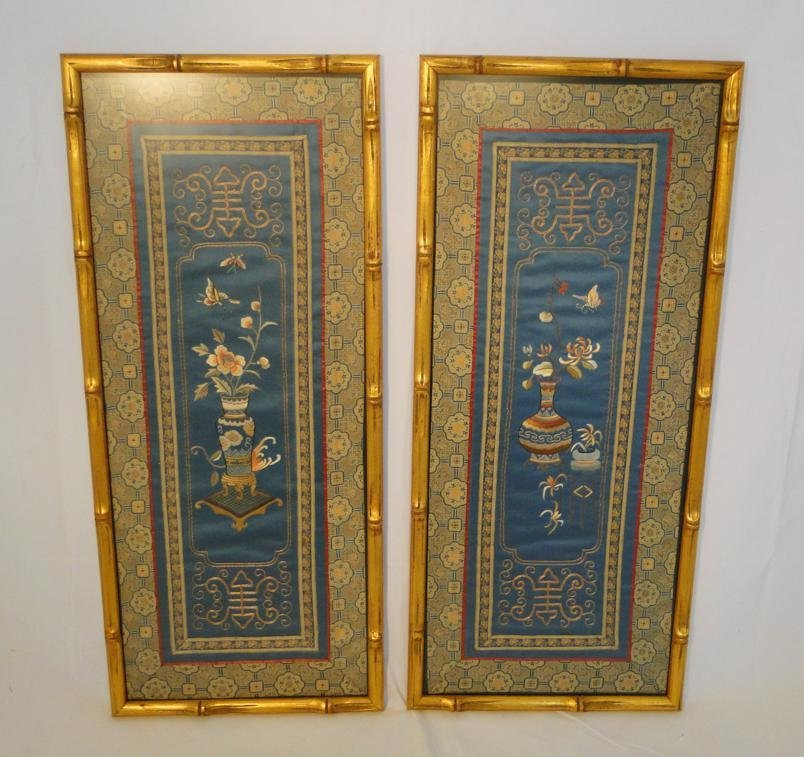 Pair of elaborate embroideries depicting vases with flo