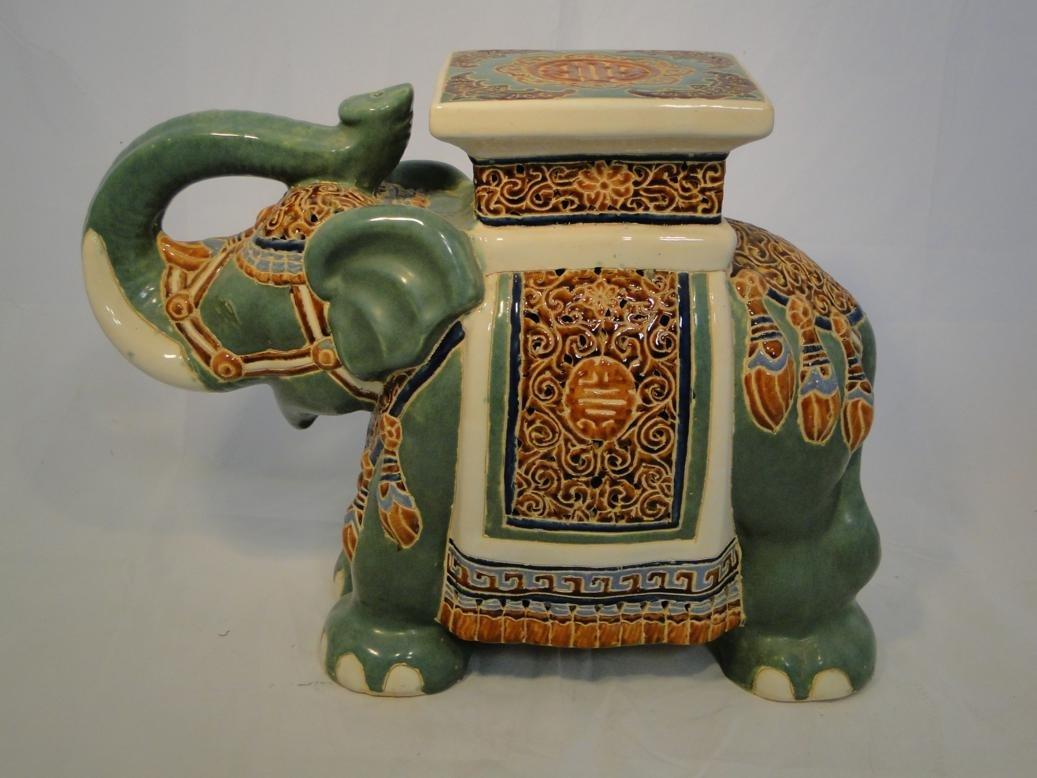 Terracotta glazed garden elephant. Measures 17in tall b