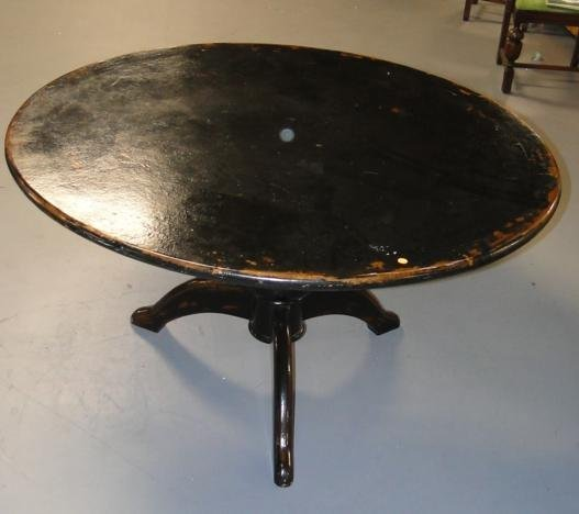 Round turnpost three legged oriental table in black lac