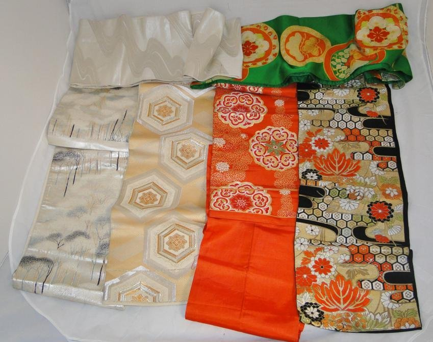 A collection of six stunning silk embroidered obis in e