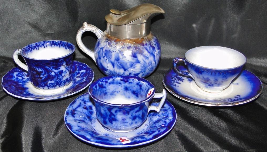 Flow Blue pewter trimmed Warwick china syrup dispenser