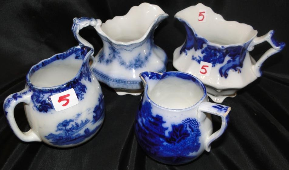 Group of 4 flow blue cream pitchers in a lot to include