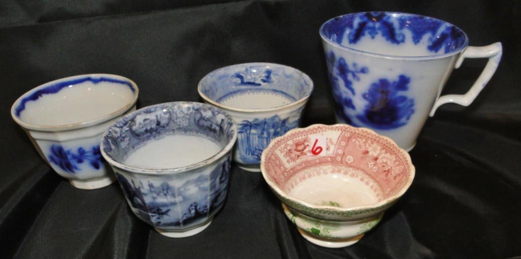 A group of 5 early cups in a lot to include flow blue.
