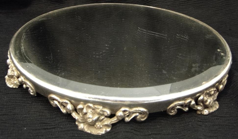 A mirrored floral silverplate plateau