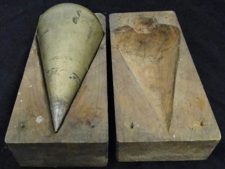 Antique carpenter's brass plumb bob in a fitted case