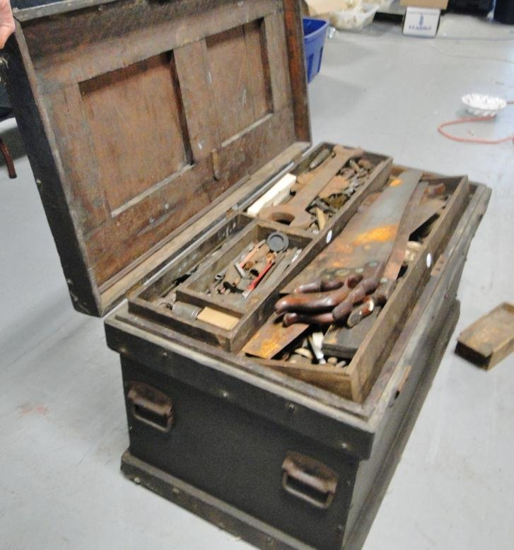 A fitted four section oak toolbox absolutely filled