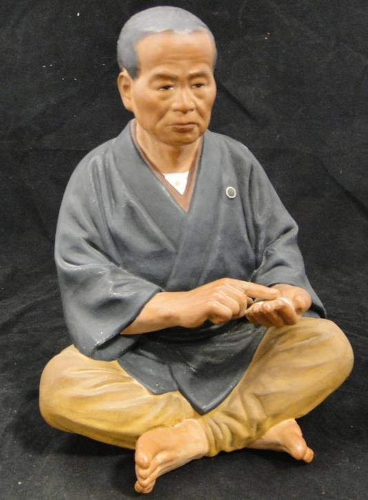 Large Japanese oriental figure of a seated man counting