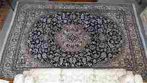 Hand tied wool and silk blend room sized oriental rug