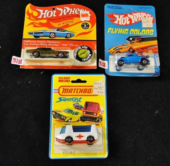 Two redline HotWheels cars in the original packaging,