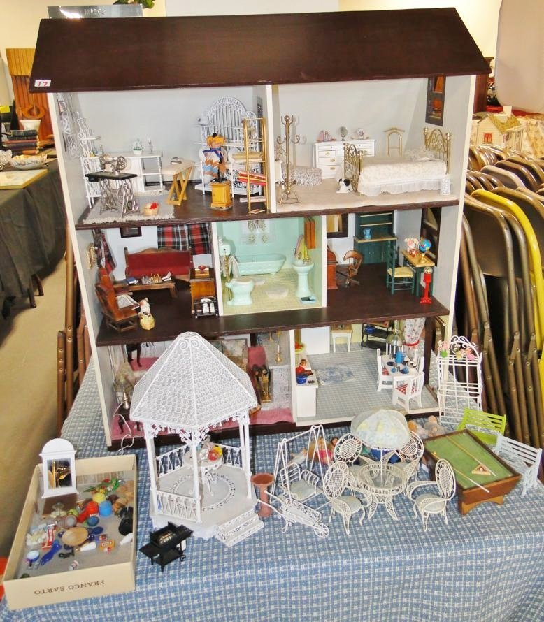Quality folk art dollhouse filled with furniture and