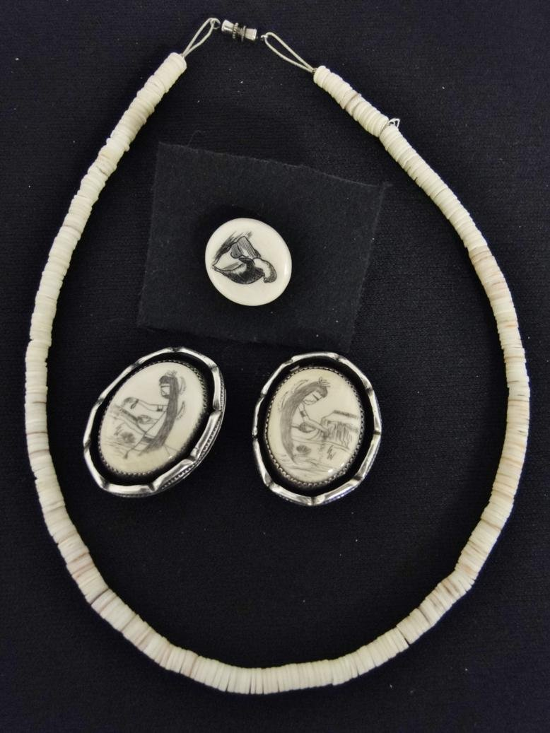 A pair of Scrimshaw and heavy sterling earrings along