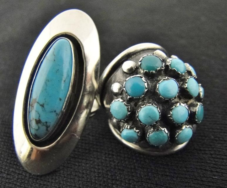 Pair of heavy sterling and turquoise stone rings. The