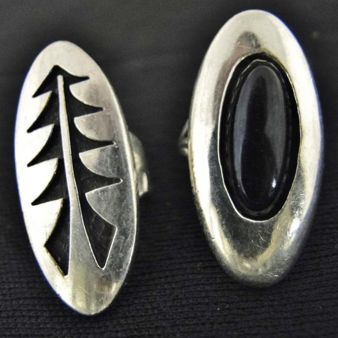 Two sterling Southwest Indian rings, both signed and in