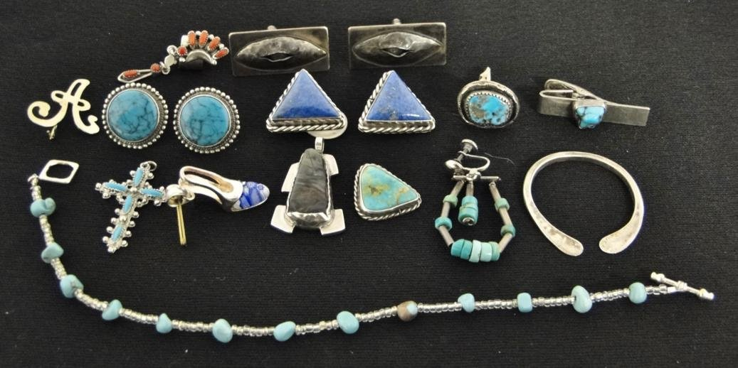 An assortment of sterling turquoise jewelry to include