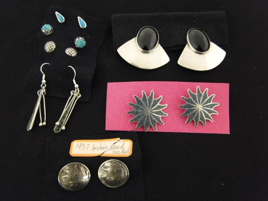 A set of 7 southwest Indian turquoise and jet earrings
