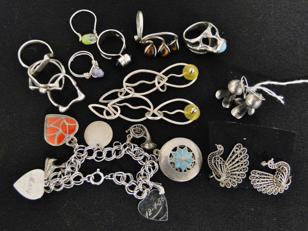 A large group of sterling jewelry to include charm