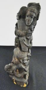 Multi-figure folk art hand carved African totem with a