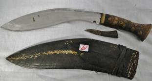 A middle eastern dagger / machette with inlaid brass