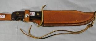 A buoy knife with a Mahogany handle and leather sheath