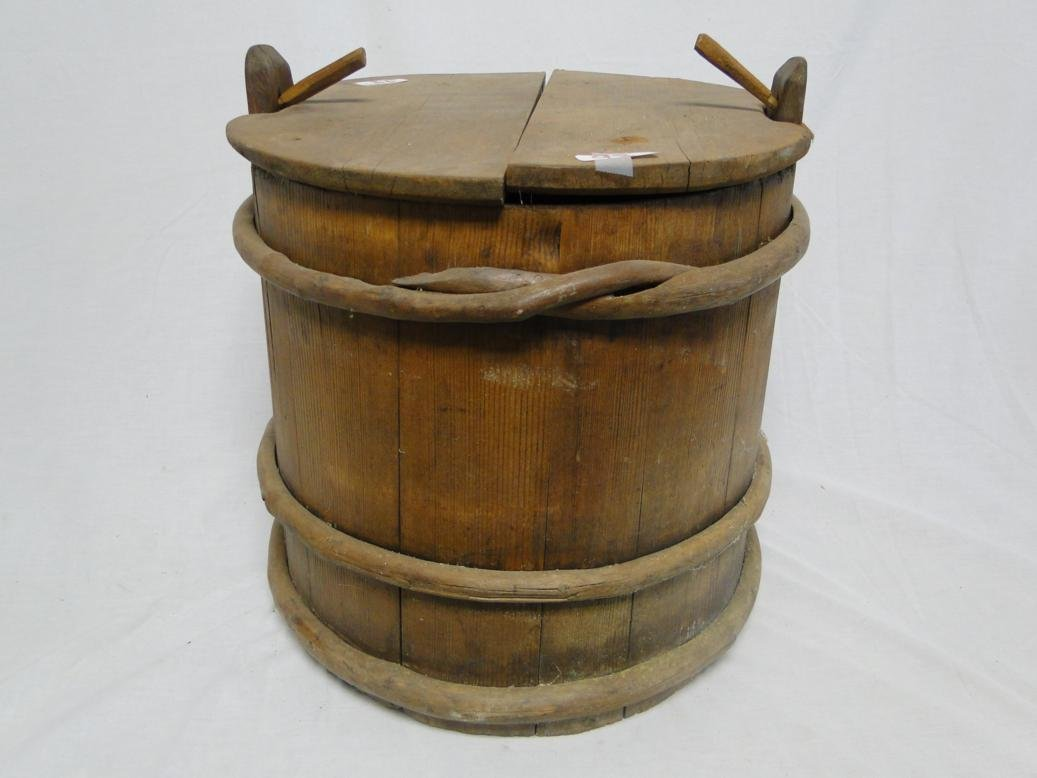 An early pine pin-clipped firkin with vine banding.  It