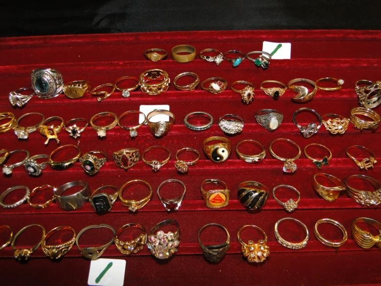 A huge tray lot of rings- costume, sterling and other.