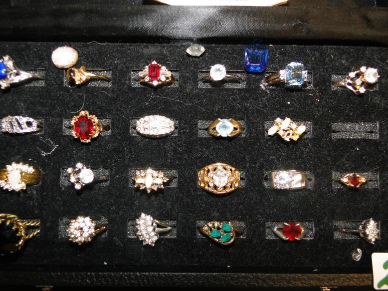 24 rings in a fitted case along with a zirconia diamond