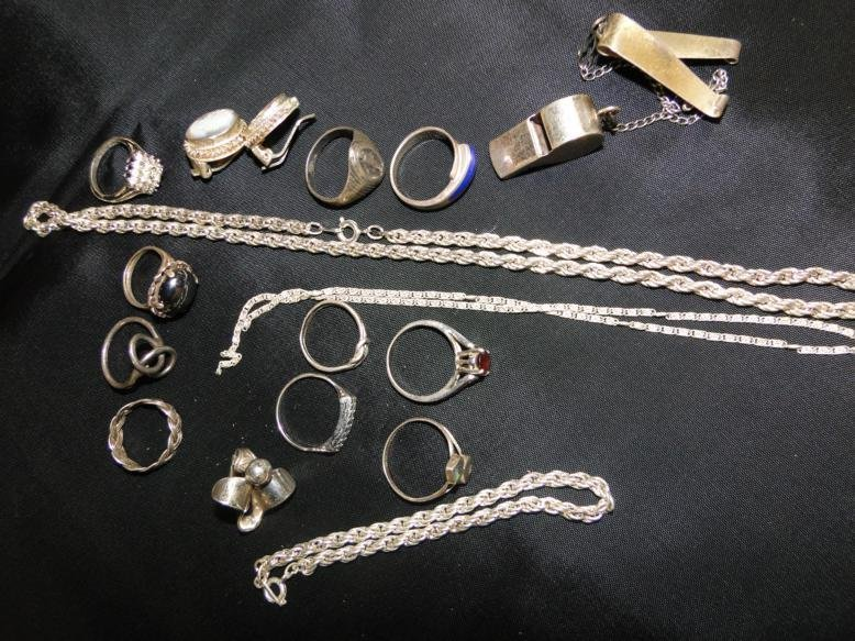 A group of sterling rings, chains and misc. in a lot.