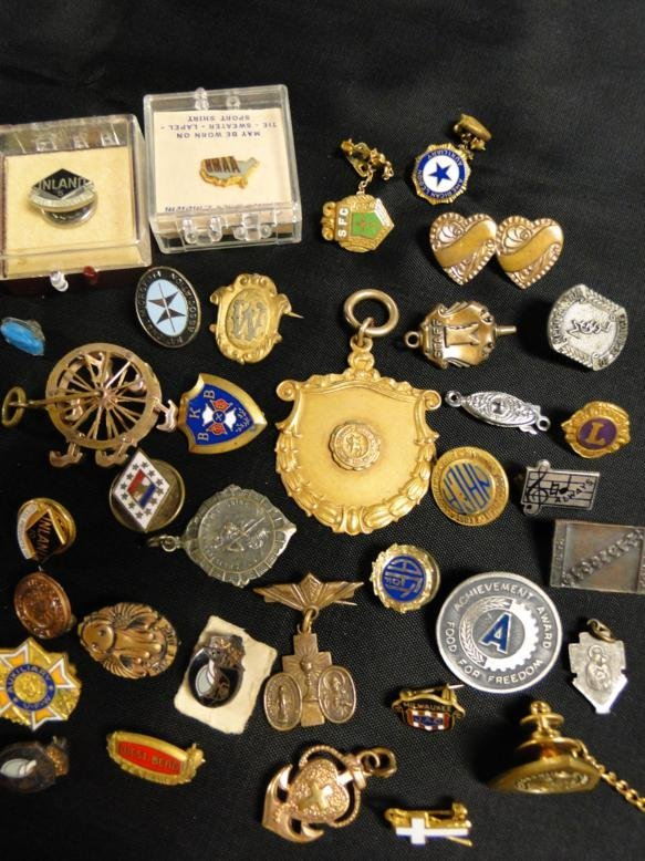 Miniature lapel pins and more in a lot.
