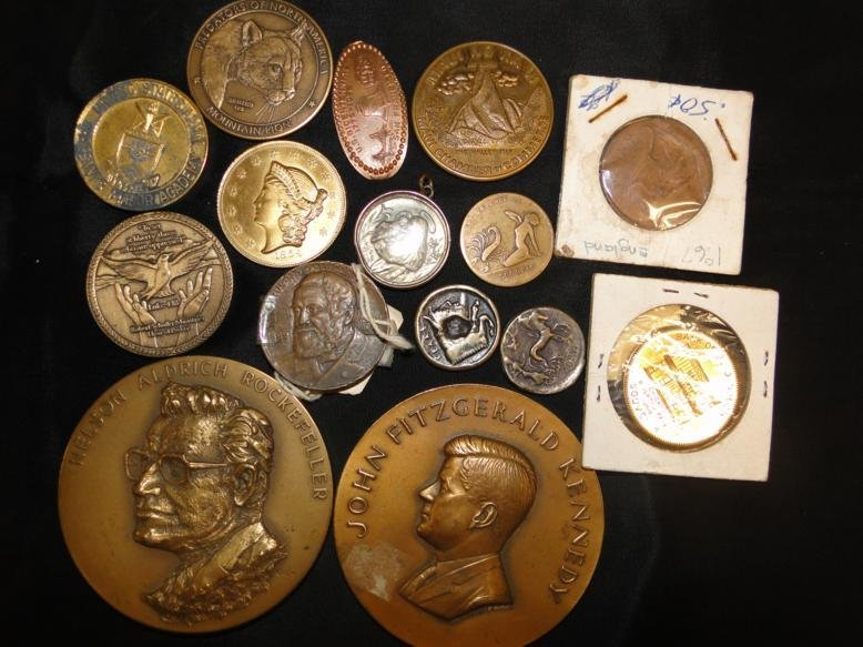 Two bronze medallions, coins and more in a lot.