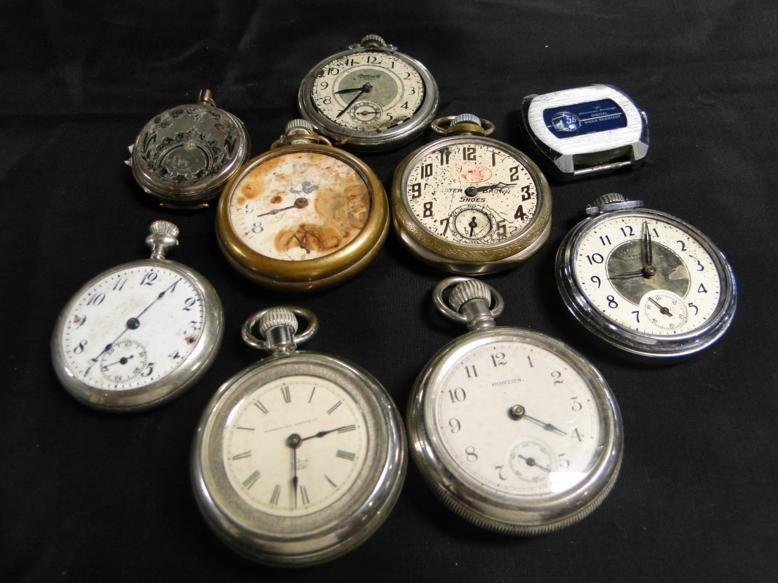 Damaged pocket watches in a lot.