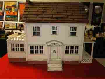 A stunning folk art 1900's hand made doll house with 10
