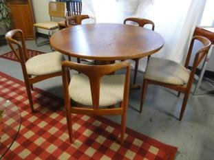 A 1960's Danish teakwood, round modern table and five