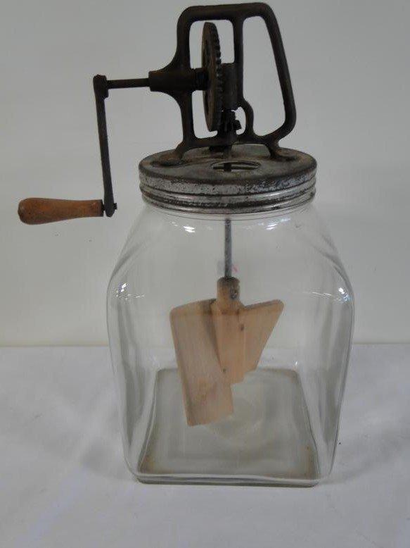 An 8 quart glass mechanical beater jar in working